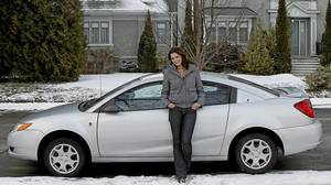 Jessica Phillips and her 2004 Saturn Ion.