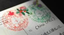 A card sent from British Columbia with a final destination to China shows the two distinctive Christmas wreath stamps which were affixed at the small post office at Christmas Island, Nova Scotia., December 8, 2011. Cards and letters arrive from around the world for the special postage stamp. (Paul Darrow for The Globe and Mail/Paul Darrow for The Globe and Mail)
