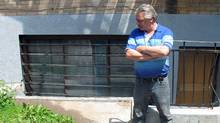Janitor Mike Nadeau stands outside an apartment complex in Montreal on May 30, 2012 near where he found a human torso inside a suitcase. (Peter Ray/Peter Ray/The Canadian Press)
