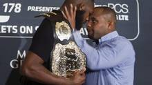 Challenger Daniel Cormier prepares to shove UFC light heavyweight champion Jon Jones during a UFC press conference to promote UFC 178 (Steve Marcus/AP)