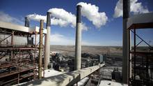 Steam rises from the stacks of the coal-fired Jim Bridger Power Plant outside Point of the Rocks, Wyoming in this file photo taken March 14, 2014. (JIM URQUHART/REUTERS)