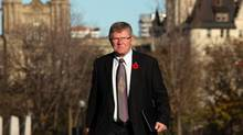 Senator Don Plett arrives at the Senate on Parliament Hill on November 4, 2013 in Ottawa. (Dave Chan For The Globe and Mail)