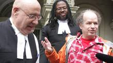 Israeli national Dror Bar-Natan, right, is seen with his lawyers Peter Rosenthal (left) and Selwyn Pieters outside the Ontario Court of Appeal in Toronto on Tuesday, April 8, 2014. (Colin Perkel/THE CANADIAN PRESS)