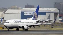In this Sept. 8, 2015, file photo, a United Airlines passenger plane lands at Newark Liberty International Airport in Newark, N.J. (Mel Evans/AP)