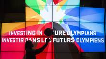 Shay Colley, a member of the Canada Women's Junior basketball team, practices her skills in from of a screen following an announcement by the Canadian Olympic Committee (COC) in Toronto on Thursday December 12, 2013. (The Canadian Press)