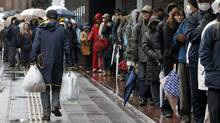 Residents in Sendai, Japan, line up for provisions on March 16, 2011. (Jo Yong-Hak/Reuters/Jo Yong-Hak/Reuters)