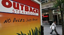 Bloomin' Brands Inc., which operates Outback Steakhouse among other restaurant brands, has a gigantic debt load. (DANIEL ACKER/BLOOMBERG NEWS)