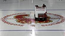A Zamboni crosses over the Calgary Flames logo as preparations proceed for the start of a shortened NHL season at the Saddledome in Calgary, Alta., Monday, Jan. 7, 2013. (Jeff McIntosh/THE CANADIAN PRESS)