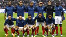 This Nov. 15, 2011 file photo shows France, from left to right back row, Eric Abidal, Adil Rami, Loic Remy, Karim Benzema, Captain and goal keeper Hugo Lloris, Mamadou Sakho, and front row from left to right, Anthony Reveillere, Marvin Martin, Yohan Cabaye, Franck Ribery,Yann M'Vila, pose prior to a friendly soccer match against Belgium at Stade de France stadium in Saint Denis, north of Paris. (Francois Mori/Associated Press)
