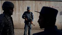 Afghan National Police during a joint patrol with American military police in Kandahar, Afghanistan. (TYLER HICKS/NYT)