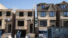 Houses are shown under construction in Toronto on Friday, June 26, 2015. Canada Mortgage and Housing Corp. says it has detected overvaluation in 11 housing markets, with other concerns flagged in Toronto, Winnipeg, Saskatoon and Regina. (GRAEME ROY/THE CANADIAN PRESS)