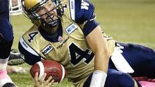 Winnipeg Blue Bombers quarterback Buck Pierce looks up after scrambling on a broken play against the Toronto Argonauts, in the first half of their CFL game in Toronto October 19, 2012. (FRED THORNHILL/REUTERS)
