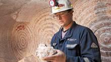 A Potash Corp. employee inspects a sample at a mine in Saskatchewan on Sept. 30, 2010. (DAVID STOBBE/David Stobbe/Reuters)