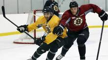 Boston Bruins forwards Patrice Bergeron, left, and Shawn Thornton compete to get to the puck during NHL practice in Wilmington, Mass., Friday, May 31, 2013. The Bruins are preparing to face the Pittsburgh Penguins in Game 1 of the Eastern Conference finals of the NHL Stanley Cup playoffs on Saturday. (Elise Amendola/AP)