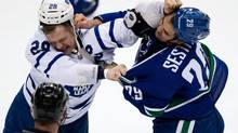 Toronto Maple Leafs' Colton Orr, left, and Vancouver Canucks' Tom Sestito fight during second period NHL hockey action in Vancouver, B.C., on Saturday November 2, 2013. (DARRYL DYCK/THE CANADIAN PRESS)