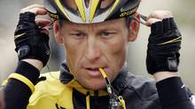 In this Feb. 22, 2009 file photo, Lance Armstrong prepares for the final stage of the Tour of California cycling race in Rancho Bernardo, Calif. (Associated Press)