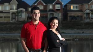 Naysan and Nahid Hariri, who have been shopping around for the best mortgage rate to finance their new home, are seen here on the site of their future home, which has yet to be built.