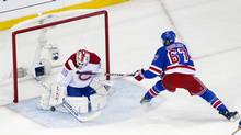 Montreal Canadiens goalie Dustin Tokarski makes a save against New York Rangers left wing Benoit Pouliot during the first period in Game 3 of the Eastern Conference Final of the 2014 Stanley Cup Playoffs at Madison Square Garden. (Andy Marlin/USA Today Sports)