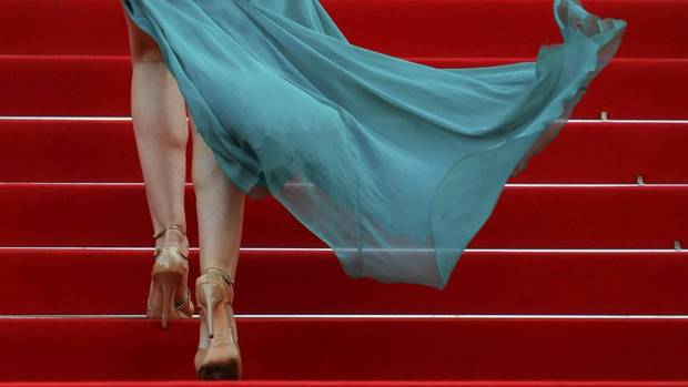 "Actress Elsa Zylberstein poses on the red carpet as she arrives for the screening of the film ""Deux jours, une nuit"" (Two Days, One Night) in competition at the 67th Cannes Film Festival in Cannes May 20, 2014. (REGIS DUVIGNAU/REUTERS)"