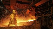 A worker separates nickel ore at a processing plant owned by PT Vale Indonesia in a file photo. (YUSUF AHMAD/REUTERS)