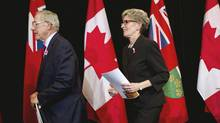 Ontario Premier Kathleen Wynne and Energy Minister Bob Chiarelli leave a press conference, Oct 8, 2013. (Moe Doiron/The Globe and Mail)