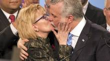New Quebec Liberal Party leader Philippe Couillard gets a kiss from his wife, Suzanne Pilote, after wining the leadership at the party's convention on Sunday, March 17, 2013 in Montreal. (Ryan Remiorz/THE CANADIAN PRESS)