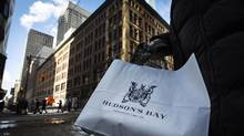 A woman holds a Hudson's Bay shopping bag in front of the Hudson's Bay Company (HBC) flagship department store in Toronto January 27, 2014. HBC is among the biggest lessors of real property in Canada and in North America. (MARK BLINCH/REUTERS)
