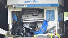 A speed boat is seen inside of a houseboat at Shuswap Lake, B.C. The speed boat crashed into the houseboat at night. killing one and injuring eight others. (Daniel Hayduk/Daniel Hayduk/The Canadian Press)
