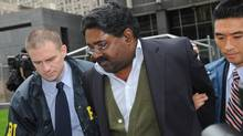 Raj Rajaratnam, billionaire founder of the Galleon Group, a major hedge fund, is led in handcuffs from FBI headquarters in New York Oct.16, 2009 (Louis Lanzano)