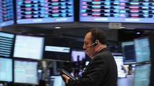 A trader works on the floor of the New York Stock Exchange on Nov. 1, 2011. (Spencer Platt/Getty Images)