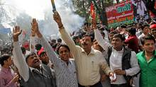 Supporters of Samajwadi Party (SP) celebrate outside their party's headquarters in the northern Indian city of Lucknow March 6, 2012. (Pawan Kumar/Reuters/Pawan Kumar/Reuters)