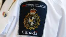 A Canada Border Services Agency (CBSA) logo is seen in this file photo. (MARK BLINCH/REUTERS)
