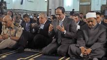 In this Oct. 4, 2014 file photo released by Egypt's official Middle East News Agency (MENA) shows Egyptian President Abdel-Fattah el-Sissi, second right, the Grand Sheik of Al-Azhar, Ahmed el-Tayeb, right, Prime Minister Ibrahim Mehleb, center, and others praying on the first day of Eid al-Aha, or Feast of Sacrifice, in Cairo, Egypt. El-Sissi opened 2015 with a dramatic call for a revolution in Islam. (Uncredited/AP)