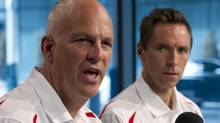 Basketball Canada general manager Steve Nash, right, listens as head coach Jay Triano speaks during a news conference in Toronto on Monday, July 29, 2013. (Frank Gunn/The Canadian Press)