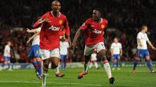 Ashley Young of Manchester United, left, celebrates with Danny Welbeck after scoring their third goal during the UEFA Champions League Group C match between Manchester United and FC Basel at Old Trafford. (Michael Regan/2011 Getty Images)