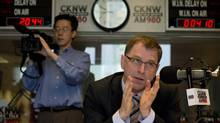 B.C. NDP Leader Adrian Dix takes part in a radio talk show in Vancouver on April 25, 2013. (Jonathan Hayward/The Canadian Press)