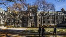 Students walk on campus at Trinity College on the University of Toronto campus on Nov. 12, 2016. (Mark Blinch/The Globe and Mail)