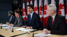 Defence Minister Harjit Sajjan, left to right, International Development Minister Marie-Claude Bibeau, Prime Minister Justin Trudeau and Foreign Affairs Minister Stephane Dion attend a news conference in Ottawa on Monday, Feb. 8, 2016. (Sean Kilpatrick/THE CANADIAN PRESS)