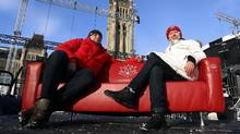 Peter Sobierajski and Ela Kinowska will travel from coast to coast to coast with a red couch to celebrate Canada's 150th birthday, inviting Canadians to share what the country means to them. (Fred Chartrand/The Canadian Press)