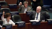 Toronto mayor Rob Ford (right) with Councillor Gloria Lindsay Luby who joined the majority who voted in favour for the hotly contested light rail transit on Sheppard Avenue East at Toronto City Hall on March 22, 2012. (Michelle Siu for The Globe and Mail/Michelle Siu for The Globe and Mail)