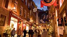 Christmas shoppers and tourists walk the Petit Champlain quarters in old historic Quebec City. (Jacques Boissinot/The Canadian Press)