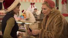 """This photo provided by The Weinstein Company shows, Rooney Mara, left, as Therese Belivet, and Cate Blanchett, as Carol Aird, in a scene from the film, """"Carol."""" The Toronto Film Critics Association has named """"Carol"""" the best picture of 2015. (Wilson Webb/THE ASSOCIATED PRESS)"""