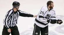 Los Angeles Kings left wing Dustin Penner (25) is escorted off the ice after a penalty during the third period of Game 2 of the NHL hockey Stanley Cup Western Conference finals against the Phoenix Coyotes, Tuesday, May 15, 2012, in Glendale, Ariz. (Matt York/Associated Press)
