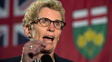 Ontario Premier Kathleen Wynne, shown in Oakville last week, is on the verge of securing Conservative support in a deal that would help move legislation from both parties forward. (Frank Gunn/THE CANADIAN PRESS)