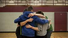 Students in Cambridge, Ont., have a group hug as they participate in a day-long anti-bullying program. (Moe Doiron/The Globe and Mail)