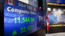 The screens at the TMX Broadcast Centre in Toronto show the TSX's closing numbers up 32.42 points on July 11, 2012. (Matthew Sherwood for The Globe and Mail)