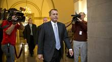 House Speaker John Boehner of Ohio arrives on Capitol Hill in Washington, Dec. 31, 2012, as leaders in the Senate and the House face pressure to find a legislative path to head off the automatic tax hikes and spending cuts set to take effect Jan. 1. (J. Scott Applewhite/AP)