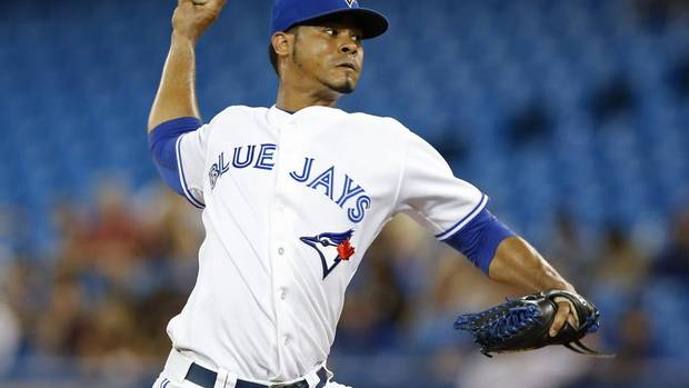 Toronto Blue Jays Esmil Rogers pitches to the Tampa Bay Rays during the first inning of their MLB American League baseball game in Toronto, July 19, 2013. (MARK BLINCH/REUTERS)
