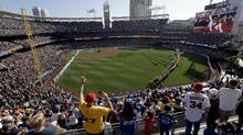 Fans cheer during the National Anthem prior to the MLB baseball All-Star Game, Tuesday, July 12, 2016, in San Diego. (Jae C. Hong/AP)