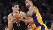 Utah Jazz center Enes Kanter (0), of Turkey, battles Los Angeles Lakers Canadian center Robert Sacre, right in the second half of an NBA preseason basketball game, Saturday, Oct. 13, 2012, in Los Angeles. Sacre, a 23-year-old seven-footer from North Vancouver, B.C., was not selected in the first round last June. In fact, he was the last pick (60th overall) in the two-round NBA draft. (Gus Ruelas/AP)